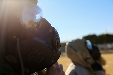Marines with Marine Wing Support Squadron 371 don Mission Oriented Protective Posture (MOPP) suits and gas masks during Chemical, Biological, Radiological and Nuclear (CBRN) decontamination and reconnaissance training aboard Marine Corps Air Station Yuma, Ariz., Jan. 13, 2016.