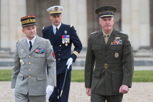 U.S. Marine Corps Gen. Joseph F. Dunford Jr., right, chairman of the Joint Chiefs of Staff, and Gen. Pierre de Villiers, chief of France's defense staff, conduct a military honors ceremony at Ecole Militarie, a military school, in Paris, Jan. 22, 2016. DoD photo by D. Myles Cullen