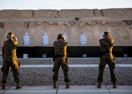 Marines stationed out of Marine Corps Air Station Yuma, Ariz., engage during firearms training and qualification at the station pistol range, Wednesday, Jan. 20, 2016. (U.S. Marine Corps photo by Cpl. Reba James)
