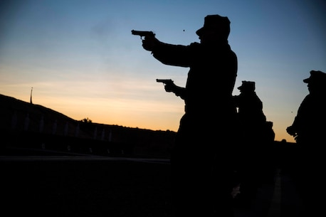 Marines stationed out of Marine Corps Air Station Yuma, Ariz., engage in firearms training and qualification at the station pistol range, Wednesday, Jan. 20, 2016. (U.S. Marine Corps photo by Cpl. Reba James)