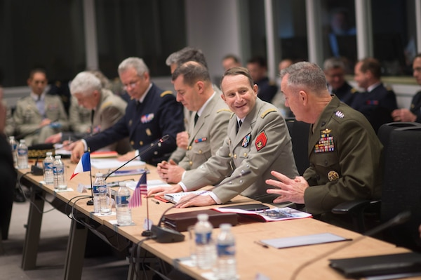 U.S. Marine Corps Gen. Joseph F. Dunford Jr., right, chairman of the Joint Chiefs of Staff, and Gen. Pierre de Villiers, chief of France's defense staff, talk during a meeting at the French defense headquarters in Paris, Jan. 22, 2016. DoD photo by D. Myles Cullen