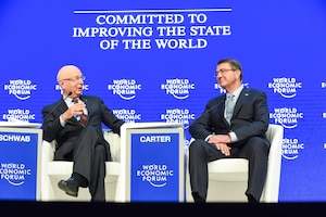 Defense Secretary Ash Carter speaks with Klaus Schwab, founder and executive chairman of the World Economic Forum, during a special session of the forum's annual meeting in Davos, Switzerland, Jan. 22, 2016. DoD photo by Army Sgt. 1st Class Clydell Kinchen