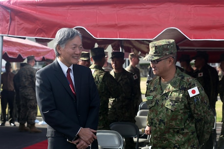Harry H. Horinouchi (left), the Consul-General of Japan, Los Angeles, speaks with Japan Ground Self Defense Force Col. Yoshiyuki Goto, Western Army Infantry Regimental Commander, following the opening ceremony of Exercise Iron Fist 2016 at Marine Corps Base Camp Pendleton, Calif., Jan. 22, 2016. Exercise Iron Fist is an annual, U.S. Pacific Command, Commander Marine Forces Pacific directed, I Marine Expeditionary Force executed, bilateral amphibious training exercise, held in Southern California. (U.S. Marine Corps photo by Cpl. Garrett White/ Released)