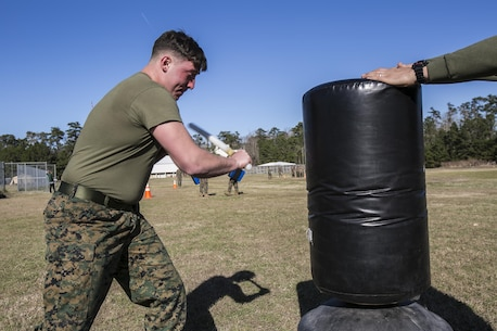 """Lance Cpl. Hunter Rooks, a Marine with Combat Logistics Battalion 22, swings at a stationary target after being sprayed in the eyes with oleoresin capsicum, more commonly known as OC spray, at Camp Lejeune N.C., Jan 14. """"I feel this was an effective means of instruction because if you or any of your Marines accidentally come in contact with the spray you're going to know what to expect,"""" said Jolly. (U.S. Marine Corps photo by Lance Cpl. Luke Hoogendam/Released)"""