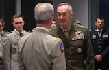 U.S. Marine Corps Gen. Joseph F. Dunford Jr., right, chairman of the Joint Chiefs of Staff, greets a senior French military officer before a meeting at the French defense headquarters in Paris, Jan. 22, 2016. DoD photo by D. Myles Cullen