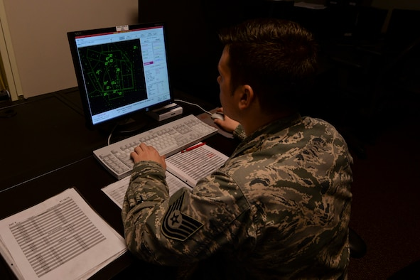 U.S. Air Force Tech. Sgt. Joshua Toellner, 23d Operation Support Squadron air traffic control craftsman, controls a simulator, Jan. 15, 2016, at Moody Air Force Base, Ga. The trainer controls the simulator so ATC trainees get the experience of controlling air traffic without a real consequence of errors. (U.S. Air Force photo by Airman 1st Class Janiqua P. Robinson/Released)