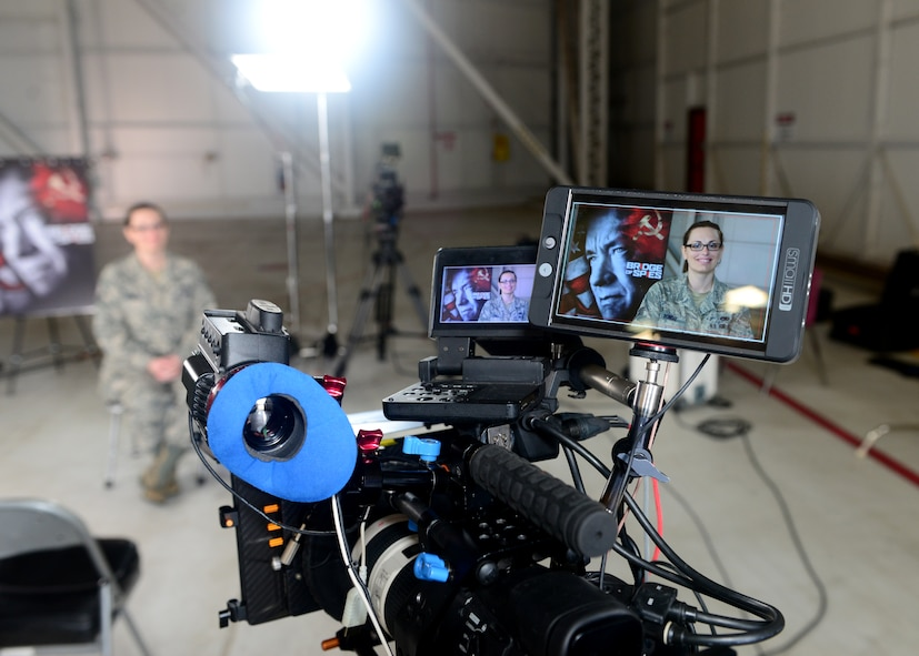 """Staff Sgt. Summer Ronso, 9th Maintenance Group maintenance scheduler, serves as a set stand-in for a DreamWorks Pictures production crew Jan. 21, 2016, at Beale Air Force Base, California. The crew was setting up equipment for interviews to be featured on the upcoming """"Bridge of Spies"""" DVD extras scheduled for release in February. (U.S. Air Force photo by Senior Airman Bobby Cummings)"""
