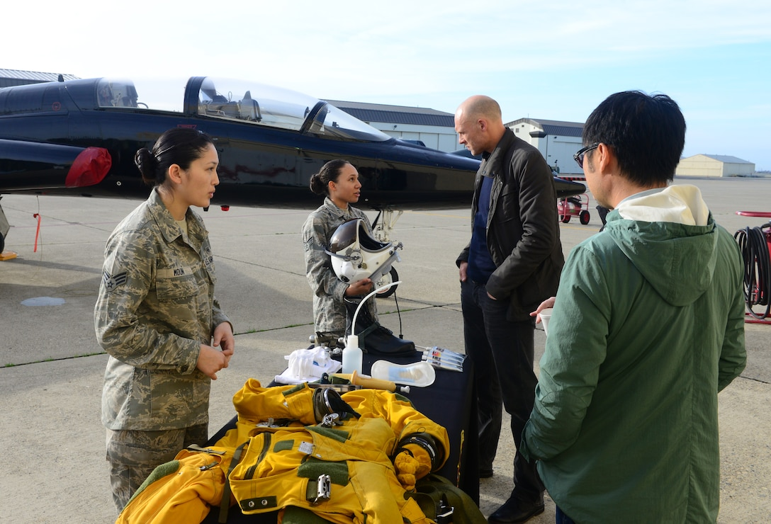 "Senior Airman Soreya Moun (left), and Senior Airman Christian Mitchell, 9th Physiological Support Squadron full-pressure suit technicians, conduct a suit demonstration for media representatives Jan. 21, 2016, at Beale Air Force Base, California. Several media outlets were invited to a DreamWorks Pictures ""Bridge of Spies"" DVD event. (U.S. Air Force photo by Senior Airman Bobby Cummings)"