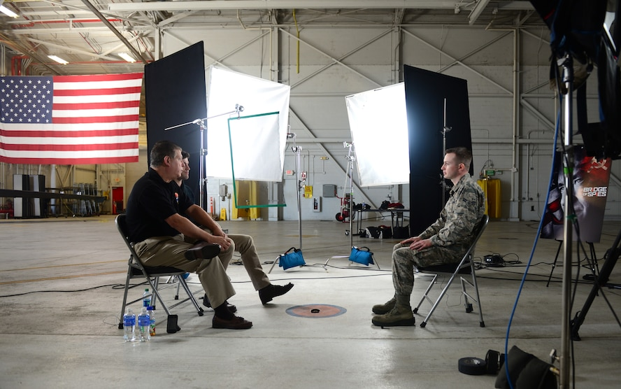 Airman 1st Class Benjamin Bugenig (right), 9th Reconnaissance Wing broadcast journalist, interviews Austin Stowell , the actor who portrayed Francis Gary Powers, in the film Bridge of Spies, and Francis Gary Powers Jr., Jan. 21, 2016, at Beale Air Force Base, California. DreamWorks Pictures returned to film DVD extra footage for the movie, which featured the U-2 Dragon Lady and was partly filmed at Beale. (U.S. Air Force photo by Senior Airman Bobby Cummings)