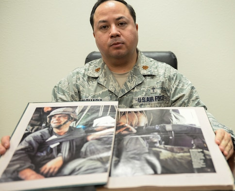 Maj. Alexander Palomaria, 366th Fighter Wing deputy chaplain, displays his scrapbook of Desert Storm-era articles and photos, Jan. 13, 2016, at Mountain Home Air Force Base, Idaho. For Palomaria, Desert Storm was the confirmation he needed to become a military chaplain. (U.S. Air Force photo by Airman 1st Class Jessica H. Evans/RELEASED)