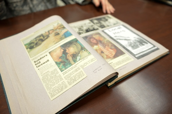 A scrapbook of Desert Storm articles and photos lays open on a table at Mountain Home Air Force Base, Idaho, Jan. 13, 2016. Maj. Alexander Palomaria, 366th Fighter Wing deputy chaplain, used scrapbooking as a way of coping with the war. (U.S. Air Force photo by Airman 1st Class Jessica H. Evans/RELEASED)