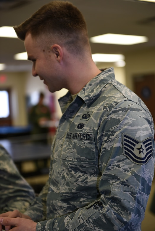 Air Force Tech. Sgt. Noah, 432nd Wing/ 432nd Air Expeditionary Wing chaplain assistant, speaks with other chapel personnel Jan. 20, 2016, at Creech Air Force Base, Nevada. Noah is the NCOIC of chapel affairs and is tasked with administrative work for the Chaplain Corps. Chaplain assistants help to provide spiritual care and opportunity for Airmen, their families, and other authorized personnel to exercise their constitutional right to the free exercise of religion. (U.S. Air Force photo by Airman 1st Class Kristan Campbell/Released)