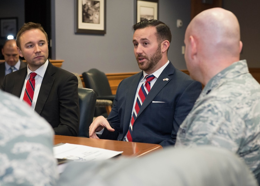 Peter Billerbeck, left, military legislative assistant to U.S. Rep. Seth Moulton, and Dennis Magnasco from the congressman's district staff talk with 66th Air Base Group Commander Lt. Col. David Dunklee and other Hanscom leaders at the base Jan. 21. The Congressional staffers also received comprehensive overview briefings from Hanscom's program executive officers, Maj Gen. Craig Olson and Steven Wert, and took a windshield tour of the base. (U.S. Air Force photo by Jerry Saslav)