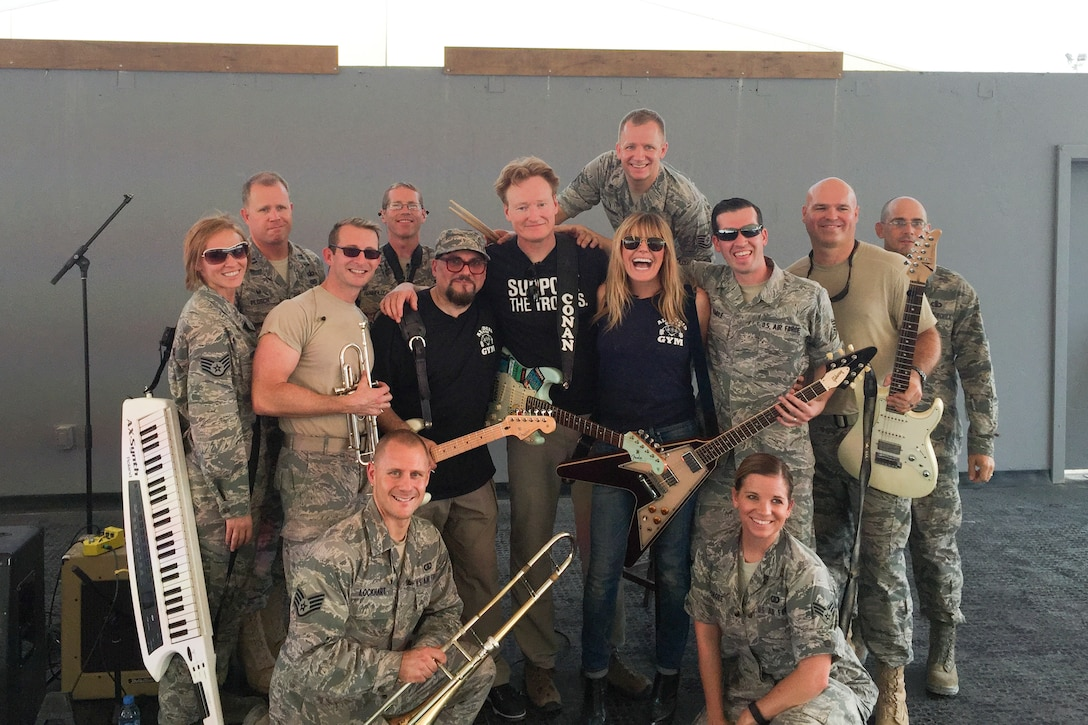 Members of the U.S. Air Force Heritage of America Band's high-energy ensemble, Full Spectrum, pose for a photo with comedian Conan O'Brien, center left, and singer Grace Potter, center right, during their deployment tour with first lady Michelle Obama. The band was deployed for roughly 110 days, and toured various locations in the Middle East and Southwest Asia. (Courtesy photo/Released)