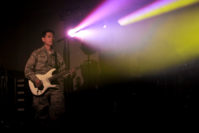 U.S. Air Force Staff Sgt. Daniel Santos, Full Spectrum guitarist, plays during a rehearsal at Langley Air Force Base, Va., Jan. 20, 2016. The band was originally created in 2013 to support U.S. and coalition forces that were deployed to Southwest Asia. (U.S. Air Force photo by Tech. Sgt. Katie Gar Ward)
