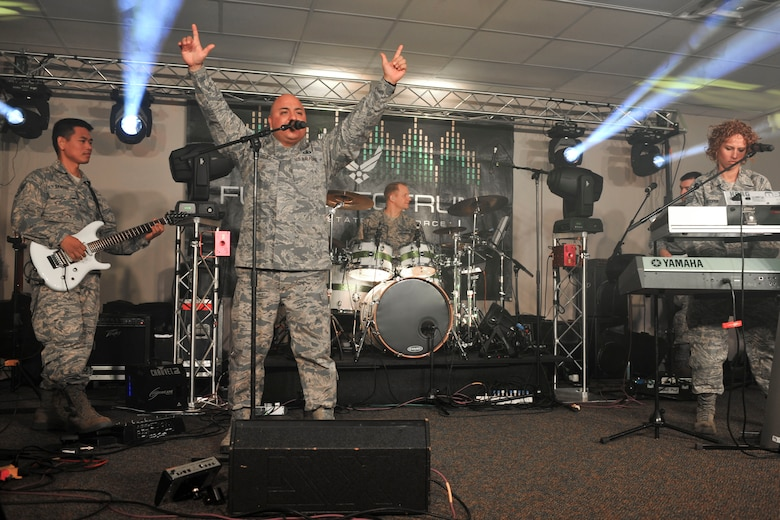The U.S Air Force Heritage of America Band's high-energy ensemble, Full Spectrum, rehearses a Langley Air Force Base, Va., Jan. 20, 2016. During its 110-day deployment to the Middle East and Southwest Asia, the band broke new ground in various regions through its community outreach efforts, and was even featured alongside comedian Conan O'Brien during his deployment tour with first lady Michelle Obama. (U.S. Air Force photo by Tech. Sgt. Katie Gar Ward)