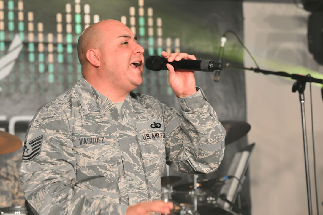 U.S. Air Force Tech. Sgt. Richard Vasquez, Full Spectrum noncommissioned officer in charge of auditions and vocals, sings during a rehearsal at Langley Air Force Base, Va., Jan. 20, 2016. The band recently deployed for 110 days to parts of the Middle East and Southwest Asia, performing in the regions' schools and malls, as well as on radio and television shows. (U.S. Air Force photo by Tech. Sgt. Katie Gar Ward)