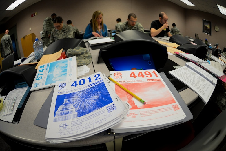 The 509th Bomb Wing legal office offered IRS tax training center volunteers at Whiteman Air Force Base, Mo. Jan. 19, 2016. Trainers used variety of guides to teach volunteers how to properly file tax returns. (U.S. Air Force photo by Senior Airman Sandra Marrero)