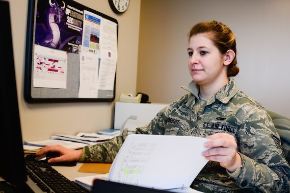 U.S. Air Force Staff Sgt. Brittany Waybright, a maintenance management production specialist assigned to the 139th Maintenance Group, checks documents at Rosecrans Air National Guard Base, St. Joseph, Mo., Jan. 22, 2016. Waybright was recently appointed the vice president of the 139th Airlift Wing's Junior Enlisted Council. (U.S. Air National Guard photo by Tech. Sgt. Michael Crane)