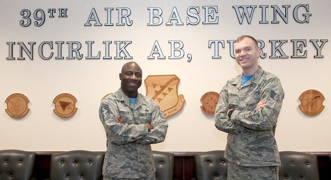 Chief Master Sgt. Vegas Clark, 39th Air Base Wing command chief, stands with Staff Sgt. Ramsey Tesch, 728th Air Mobility Squadron unit deployment manager, in the 39th ABW conference room before beginning Tesch's chief shadow day Jan. 22, 2016. Airmen are chosen for the command chief's shadow program based on their commander's recommendation about their dedication to the mission and their job. (U.S. Air Force photo by Staff Sgt. Jack Sanders)