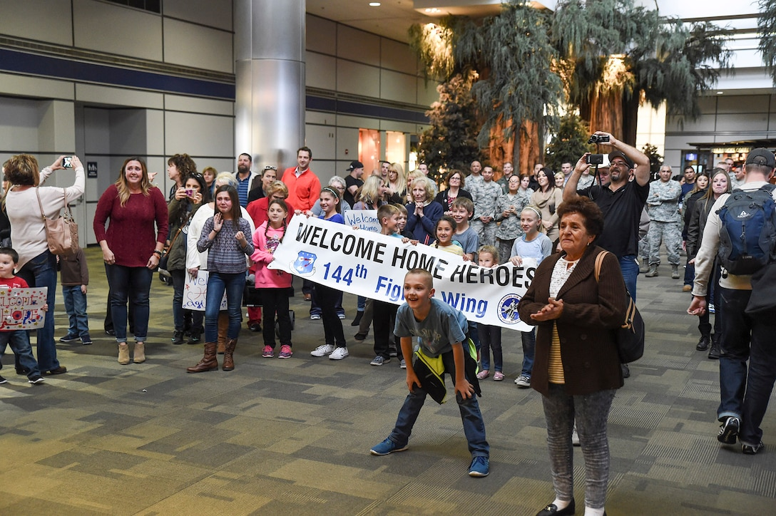 Family and friends of the 144th Security Forces Squadron prepare to greet Airmen who are returning from a deployment of more than seven months in support of Operation Enduring Freedom. The first group returned Jan. 21, 2015 at the Fresno Yosemite International Airport. (U.S. Air National Guard photo by Senior Master Sgt. Chris Drudge)