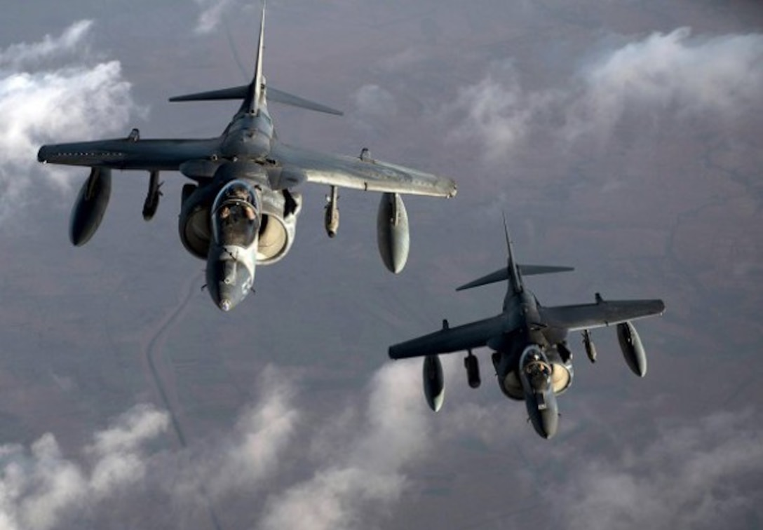 U.S. Marine Corps Harriers receive fuel from an Air Force KC-135 Stratotanker over Southwest Asia, Aug. 25, 2015. Coalition forces fly daily missions in support of Operation Inherent Resolve. (United States Air Force photo by Senior Airman Taylor Queen)