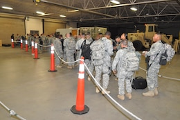Soldiers assigned to the 88th Military Police Company, U.S. Army Reserve, turned in weapons at the Silas L. Copeland Arrival/Departure Air Control Group Dec. 18, 2015. The unit provided external security at Guantanamo Naval Base, Cuba.
