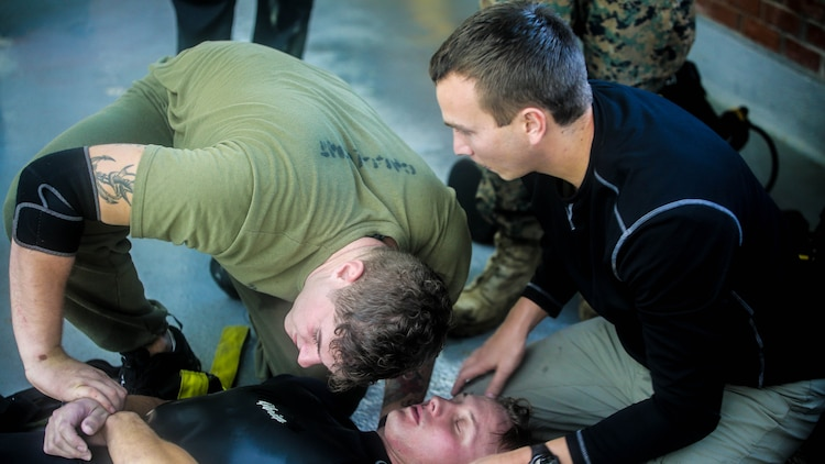 Marines with 2nd Reconnaissance Battalion run through the proper procedures they need to take when a diver becomes unconscious during a dive supervisor course at Camp Lejeune, N.C., Jan. 19, 2016. The course certifies Marines as dive supervisors whose mission is to oversee dives and ensure that operations are conducted safely and effectively.