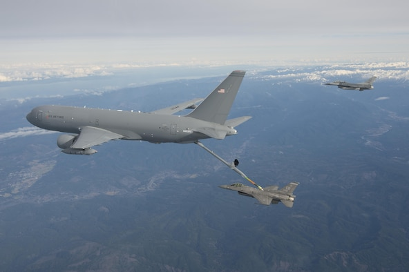 The KC-46A Pegasus performs its first-ever aerial refueling Jan. 24, 2016, passing 1,600 pounds of fuel to an F-16 Fighting Falcon. (Boeing photo/Paul Weatherman)