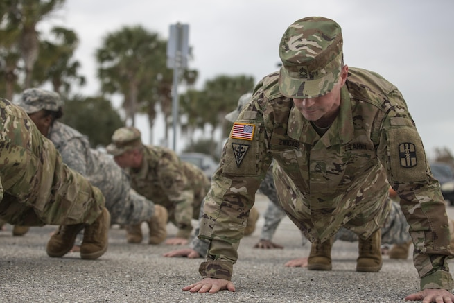Soldiers of the Army Reserve Medical Command, 3rd Medical Command (Deployment Support) and the 807th Medical Command (Deployment Support) perform pushups during closing formation at the C.W. Bill Young Armed Forces Reserve Center in Pinellas Park, Fla., Jan. 22, 2016. (U.S. Army photo by Spc. Tracy McKithern/Released)