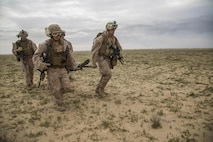 U.S. Marines with Charlie Company, 1st Battalion 7th Marine Regiment, Special Purpose Marine Air-Ground Task Force-Crisis Response-Central Command, recover a simulated casualty as part of a Tactical Recovery of Aircraft and Personnel exercise at an Undisclosed Location in Southwest Asia Jan. 12, 2016. SPMAGTF-CR-CC is ready to respond to any crisis response mission in theater to include the employment of a TRAP force. (U.S. Marine Corps photo by Cpl. Akeel Austin/Released)