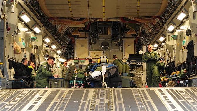 Members of the 315th Airlift Wing at Joint Base Charleston, S.C. prepare for departure for a training mission to Ramstein Air Base, Germany Jan. 21, 2016.