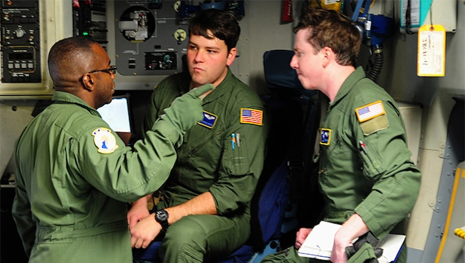 Chief Master Sgt. Reggie Godbolt, the loadmaster superintendent for the 300th Airlift Squadron at Joint Base Charleston, explains expectations to his loadmasters during a training mission to Ramstein Air Base, Germany, Jan. 21, 2016.