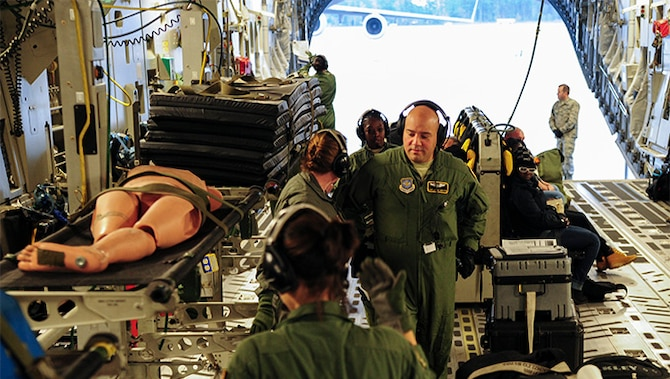 Airmen from the 315th Aeromedical Evacuation Squadron at Joint Base Charleston, S.C. and the 48th AES at Pope Air Force Base, load a stretcher during a training mission to Ramstein Air Base, Germany, Jan. 21, 2016.