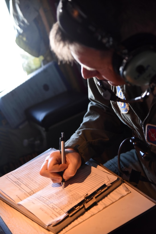 Senior Master Sgt. Jay Latham logs information from a dropsonde released into the blizzard that impacted the East Coast Jan. 22-24, 2016. The dropsondes collect information on the storm's wind speed and direction, temperature, and barometric pressure and the data is sent back to the National Hurricane Center where it is used in forecast models produced by the National Center for Environmental Prediction. (U.S. Air Force photo/Staff Sgt. Nicholas Monteleone)
