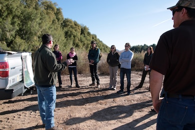 Arizona Game and Fish Department staff brief Los Angeles District regulatory representatives on the state's Arlington Wildlife Area Jan. 20. The AWA is a potential in-lieu fee program site for public and private projects seeking an Army permit under the Clean Water Act.