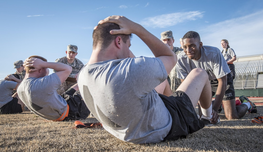Army ROTC cadet Jean-Luc Sambira, right, holds the feet of cadet Evan Murphy during the sit-up portion of an Army Physical Fitness Test at Clemson University, S.C., Jan. 14, 2016. U.S. Army photo by Staff Sgt. Ken Scar