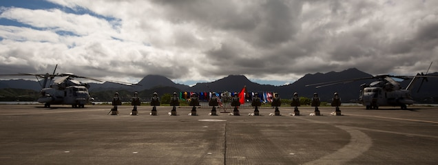 The display of the battlefield crosses over the flight line during a memorial ceremony honoring 12 Marines from Marine Heavy Helicopter Squadron 463 aboard Marine Corps Air Station Kaneohe Bay, Jan. 22, 2016. Two CH-53E Super Stallion helicopters with HMH-463 were involved in an incident off the coast of North Shore, Oahu, Hawaii, Jan. 14.