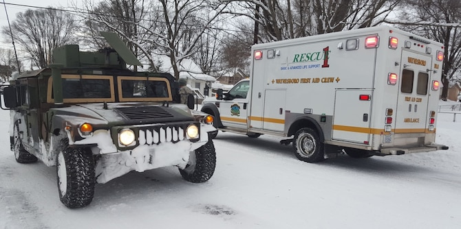 Virginia National Guard Soldiers assigned to the Pulaski-based Company D, 1st Battalion, 116th Infantry Brigade Combat Team assist the Waynesboro First Aid Crew with a rescue call Jan. 23, 2016, near Waynesboro, Va. The first-aid crew was unable to reach the location of the call with their ambulance, so the Soldiers drove them to the residence, cleared them a path in the snow, then transported the patient back to the ambulance for evacuation. (Courtesy photo)