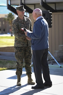 The Honorable Dennis V. McGinn, Assistant Secretary of the Navy, presents the Exercise Support Division's 2015 Secretary of the Navy Energy and Water Management Award in the United States Marine Corps Expeditionary category to Lt. Col. Randal Pape, officer in charge, ESD, at Lance Cpl. Torrey L. Gray Field, Jan. 21, 2016. (Official Marine Corps photo by Cpl. Medina Ayala-Lo/Released)