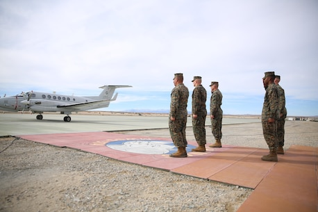 Combat Center leadership salutes the Honorable Dennis V. McGinn, Assistant Secretary of the Navy and Mr. Joseph Bryan, Deputy Assistant Secretary of the Navy, as they land at the Strategic Expeditionary Landing Field, Jan. 21, 2016. McGinn later awarded the Combat Center's Exercise Support Division the 2015 Secretary of the Navy Energy and Water Management Award in the United States Marine Corps Expeditionary category. McGinn also recognized the Combat Center as an installation, for a Gold Level of Achievement under the awards program, which indicates a very good to outstanding energy or water program. (Official Marine Corps photo by Cpl. Medina Ayala-Lo/Released)