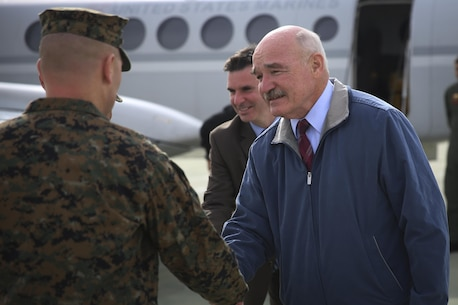 Col. Jay Wylie, assistant chief of staff, G-4 Installations and Logistics, greets the Honorable Dennis V. McGinn, Assistant Secretary of the Navy, at the Strategic Expeditionary Landing Field, Jan. 21, 2016. McGinn later awarded the Combat Center's Exercise Support Division the 2015 Secretary of the Navy Energy and Water Management Award in the United States Marine Corps Expeditionary category, at Lance Cpl. Torrey L. Gray Field. McGinn also recognized the Combat Center as an installation, for a Gold Level of Achievement under the awards program, which indicates a very good to outstanding energy or water program.  (Official Marine Corps photo by Cpl. Medina Ayala-Lo/Released)