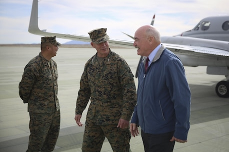 Maj. Gen. Lewis A. Craparotta, Combat Center Commanding General, welcomes the Honorable Dennis V. McGinn, Assistant Secretary of the Navy, at the Strategic Expeditionary Landing Field, Jan. 21, 2016. McGinn later awarded the Combat Center's Exercise Support Division the 2015 Secretary of the Navy Energy and Water Management Award in the United States Marine Corps Expeditionary category, at Lance Cpl. Torrey L. Gray Field. McGinn also recognized the Combat Center as an installation, for a Gold Level of Achievement under the awards program, which indicates a very good to outstanding energy or water program. (Official Marine Corps photo by Cpl. Medina Ayala-Lo/Released)