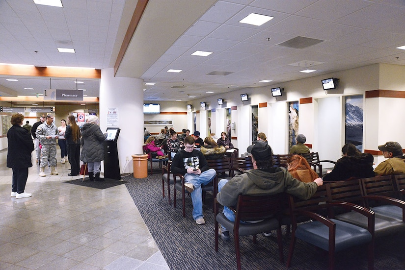 Patients remain in the extended pharmacy waiting area during the busiest time of day, lunch time, at the hospital on Joint Base Elmendorf-Richardson, Alaska, Jan. 19, 2015. The seating area doubled since the redesign so patients have more room to sit. (U.S. Air Force photo by Airman 1st Class Christopher R. Morales)