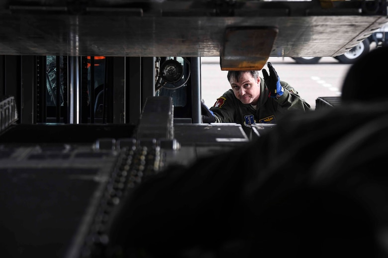 U.S. Air Force Master Sgt. Daryl Martini, New York Air National Guard's 105th Airlift Wing load master, helps load a C-17 Globemaster III at the Fresno Air National Guard Base, Jan. 21, 2016, in support of the 144th Fighter Wing's participation in Red Flag 16-01. Red Flag is a realistic combat training exercise, which is hosted by Nellis Air Force Base, Nevada and the U.S. Air Force Warfare Center. The 105th AW airlifted 12 pallets and 29 personnel assigned to the 144th FW. (U.S. Air National Guard Senior Airman Klynne Pearl Serrano)