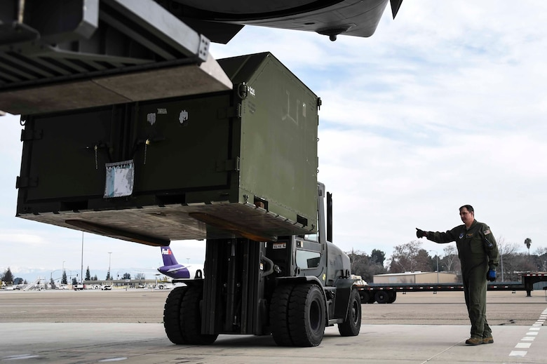 U.S. Air Force Master Sgt. Daryl Martini, a New York Air National Guard 105th Airlift Wing load master, helps load a pallet aboard a C-17 Globemaster III at the Fresno Air National Guard Base, Jan. 21, 2016, in support of the 144th Fighter Wing's participation in Red Flag 16-01. Red Flag is a realistic combat training exercise, which is hosted by Nellis Air Force Base, Nevada and the U.S. Air Force Warfare Center. The 105th AW airlifted 12 pallets and 29 personnel assigned to the 144th FW. (U.S. Air National Guard Senior Airman Klynne Pearl Serrano)