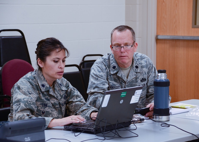 Lt. Col. Grace Link, commander of Task Force Recovery, and Lt. Col. Lane Endicott, 131st Civil Engineer Squadron commander, set up operations at Jefferson Barracks Air National Guard Base, Missouri, Jan. 6, 2016. The task force, led by the Missouri National Guard and supported by the Federal Emergency Management Agency, the U.S. Army Corps of Engineers and other federal and state agencies, is charged with helping individuals, businesses and communities remove debris and recover following historic flooding across the state. (U.S. Air National Guard photo by Staff Sgt. Brittany Cannon)