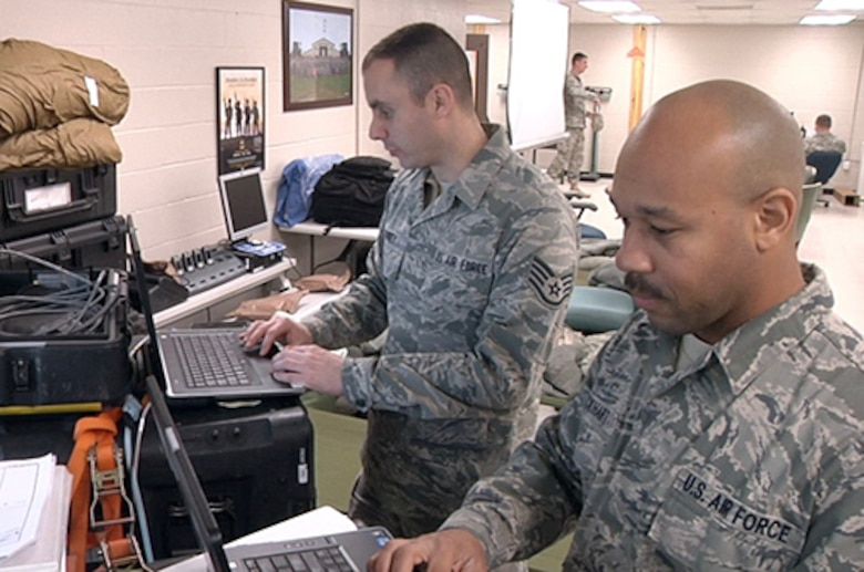 Citizen Airmen of the 239th Combat Communication Squadron set up, operate and maintain the Joint Task Force Headquarters Joint Incident Site Communication Capability, or JISCC system, providing satellite-based telephone, network and email capability to the Festus, Missouri based operation, January 6, 2016.  (Courtesy Photo)