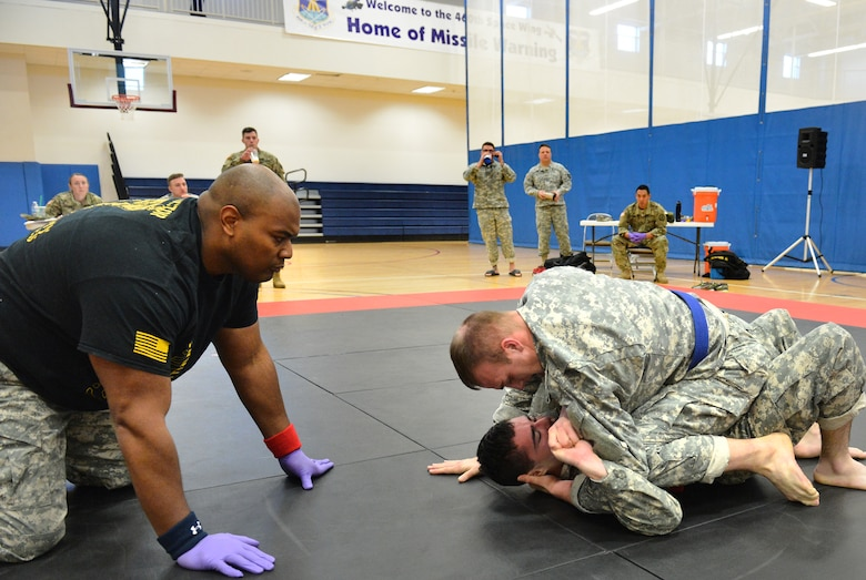 Two U.S. Army 743rd Military Intelligence Battalion Squadron soldiers compete for commander's cup points during a combatives tournament at the Buckley Fitness Center Jan. 22, 2015, on Buckley Air Force Base, Colo. The army battalion hosts the tournament every year to hone hand-to-hand combat training techniques while engaging in friendly competition. (U.S. Air Force photo by Staff Sgt. Darren Scott/Released)