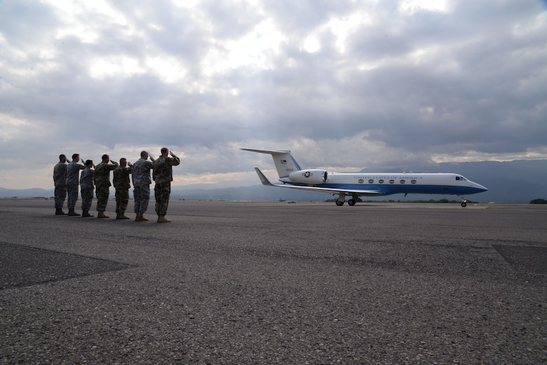 U.S. Military members salute U.S. Navy Adm. Kurt W. Tidd, Southern Command commander plane as it leaves Soto Cano Air Base, Honduras, Jan. 22, 2016. Tidd visited Joint Task Force-Bravo to gain a better understanding of JTF-Bravo's mission set and to reach out and receive feedback from the men and women that serve to protect the United States from afar. (U.S. Air force photo by Senior Airman Westin Warburton/Released)